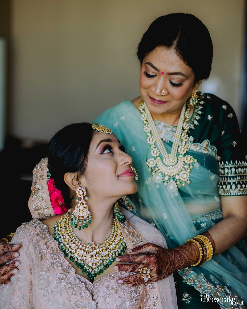 Photo of Bride and mother looking at each other.