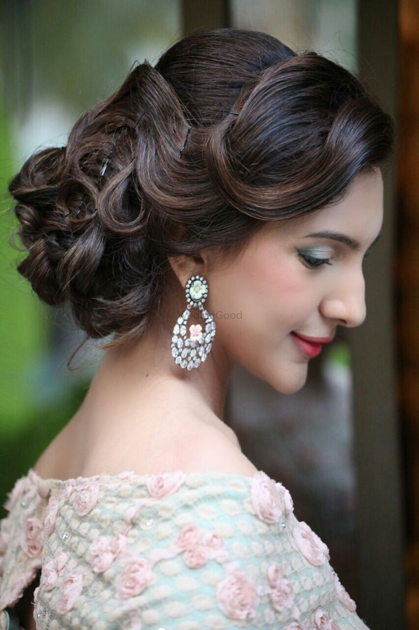 Photo of Sideswept Wavy Bun for Engagement or Sangeet