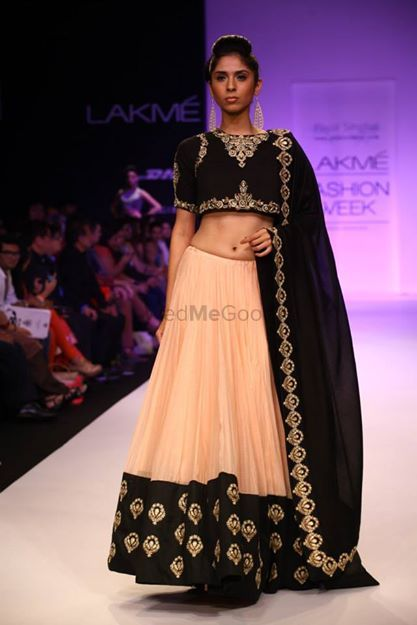 Photo of Payal Singhal blush and black lehenga with crop top