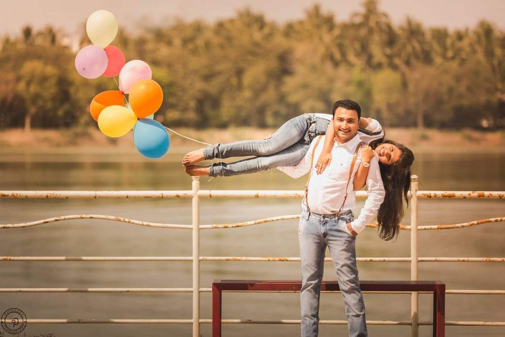 Photo of Couple Fun Pre Wedding Shoot with Balloons on Feet