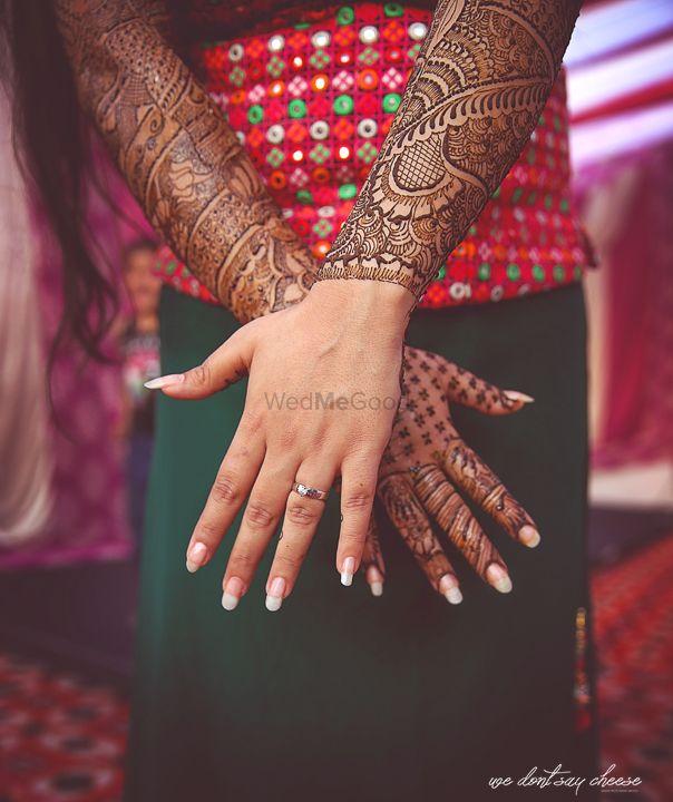 Photo of Mehendi and engagement ring