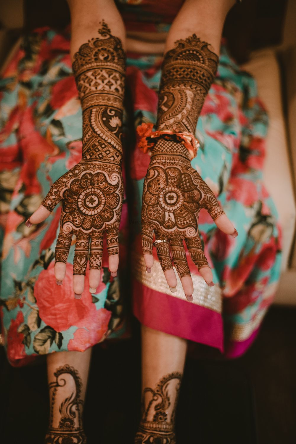 Photo of A bride flaunting her mehendi