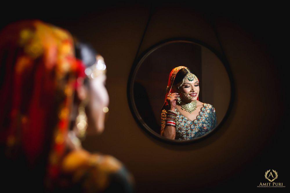 Photo of Bridal getting ready shot in mirror blue lehenga