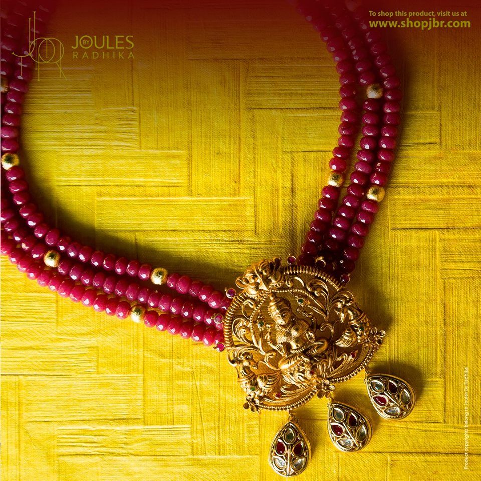 Photo of Gold temple jewellery with maroon beads