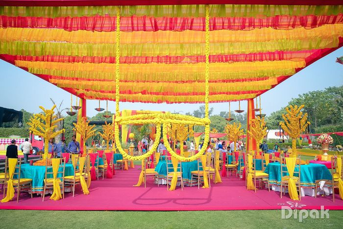 Photo of Colourful Mehendi Decor with Genda Phool Sunglasses