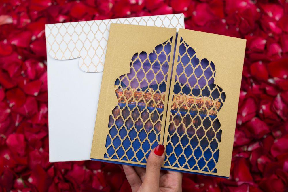 Photo of jaali cut invitation cards