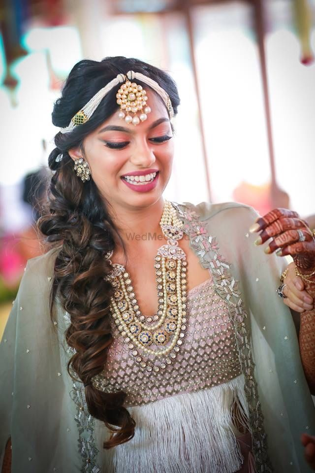 Photo of Bride-to-be in unique jewellery