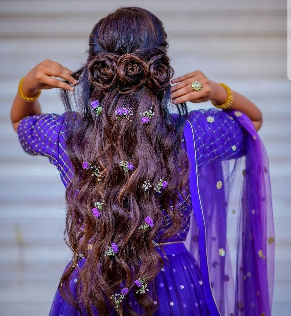 Photo of Half up - half down hairstyle with tiny flowers