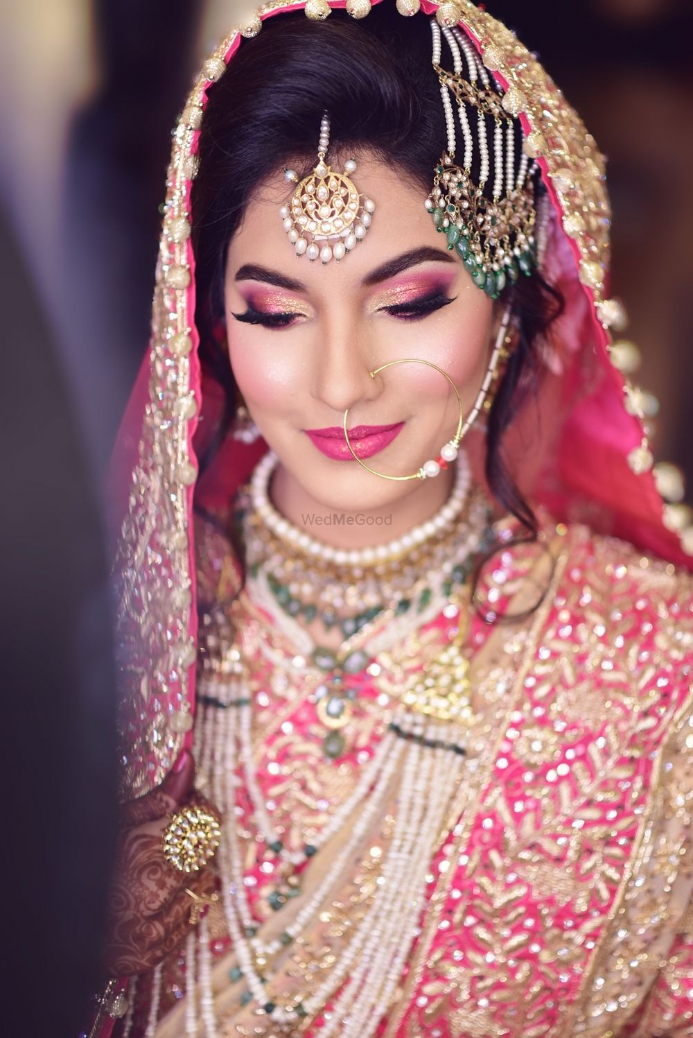 Photo of Muslim bridal look with pink smokey eyes