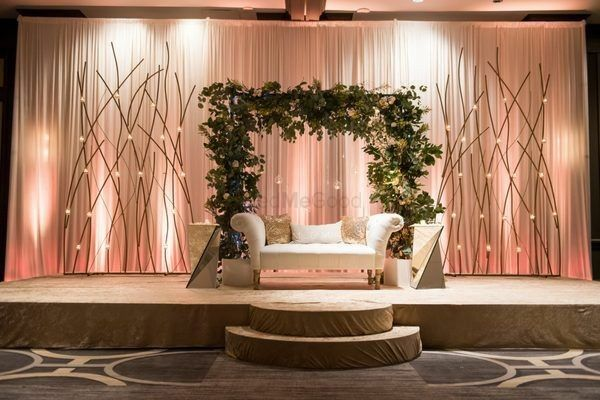 Photo of A sleek stage setup with drapes and plant wreath