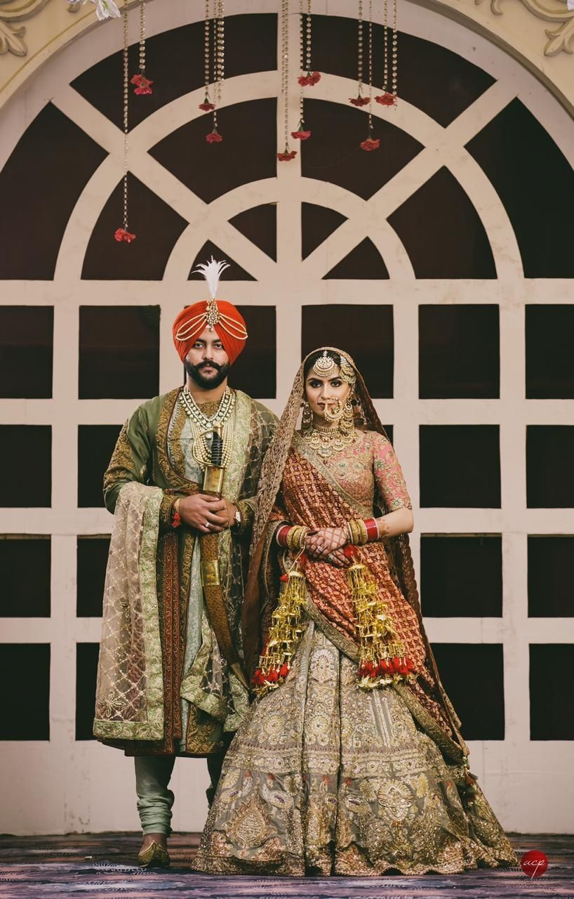 Photo of A sikh couple coordinates in royal outfits in metallic colors