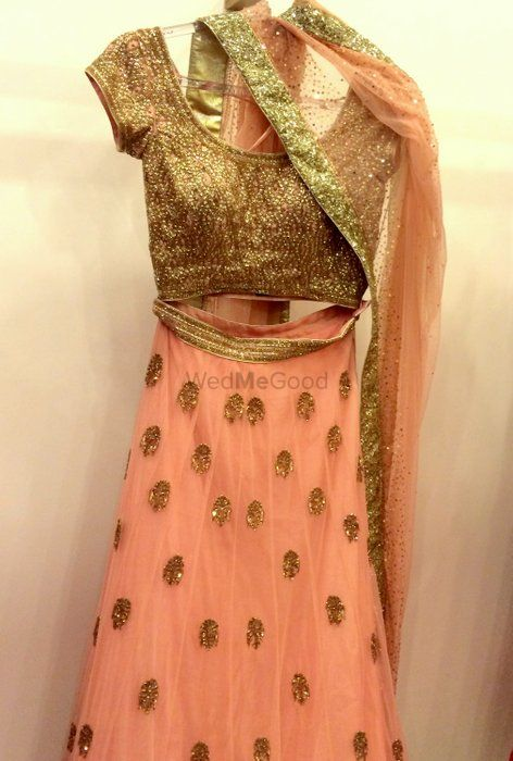 Photo of peach lehenga with delicate gold work