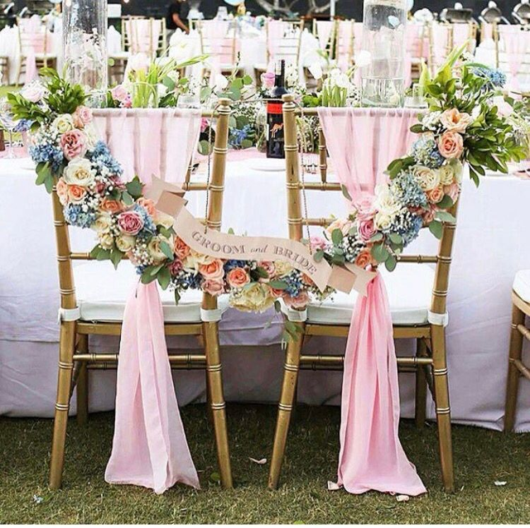 Photo of Unique floral bride and groom chairs