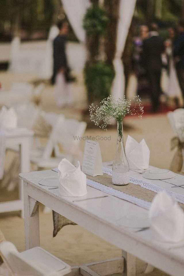 Photo of Beach cocktail with table setting simple centerpiece