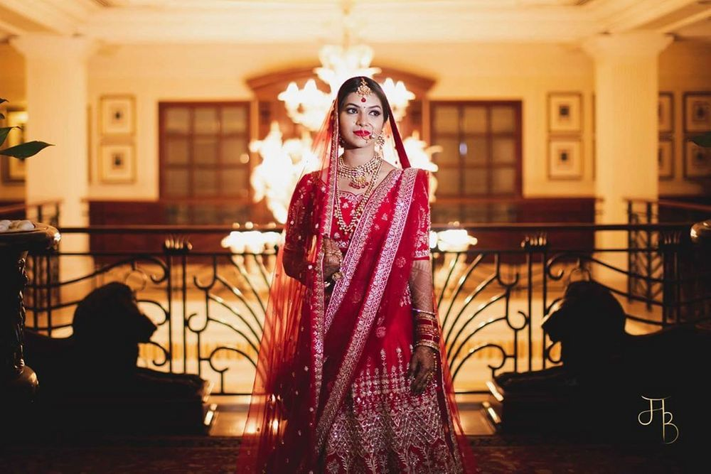 Photo of timeless bride in a red lehenga