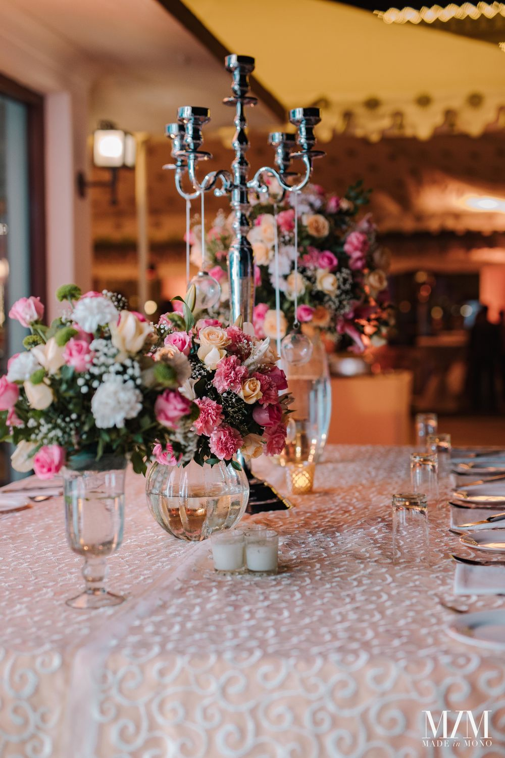 Photo of elegant floral centrepiece idea for wedding or cocktail