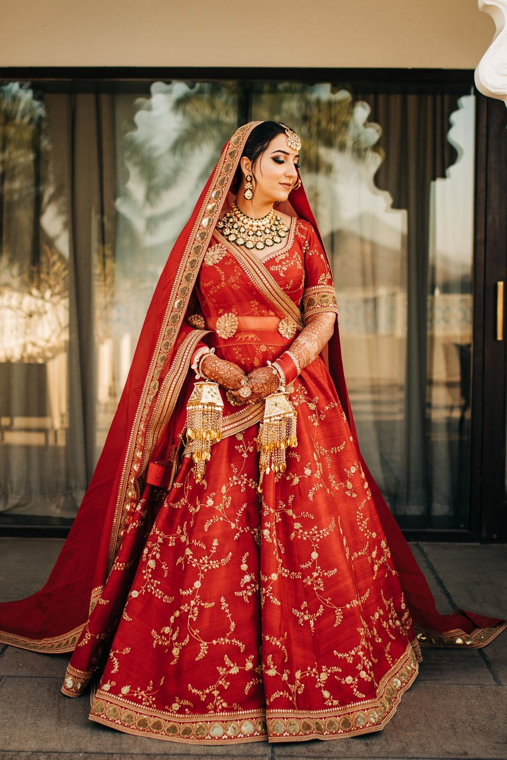 Photo of A bride dressed in red traditional lehenga