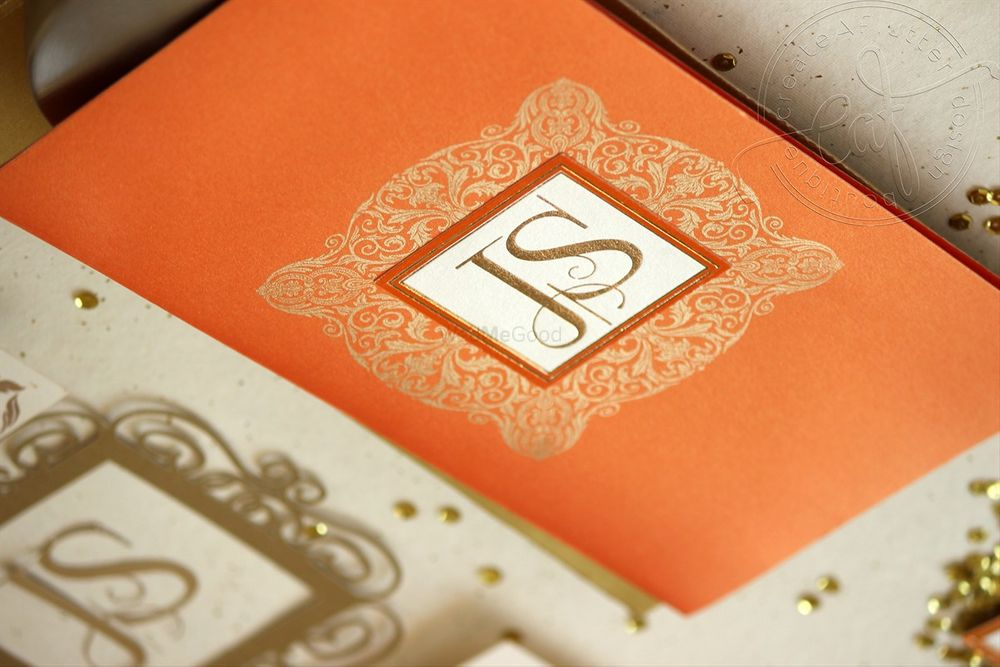Photo of Orange rust wedding card with initials