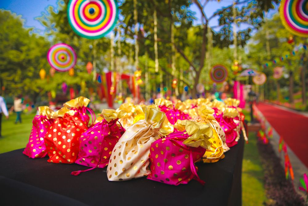 Photo of Mehendi favours in cute potlis on table