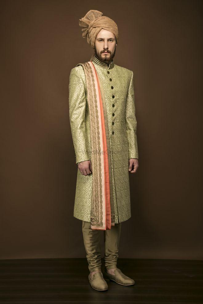 Photo of Light green sherwani with orange dupatta