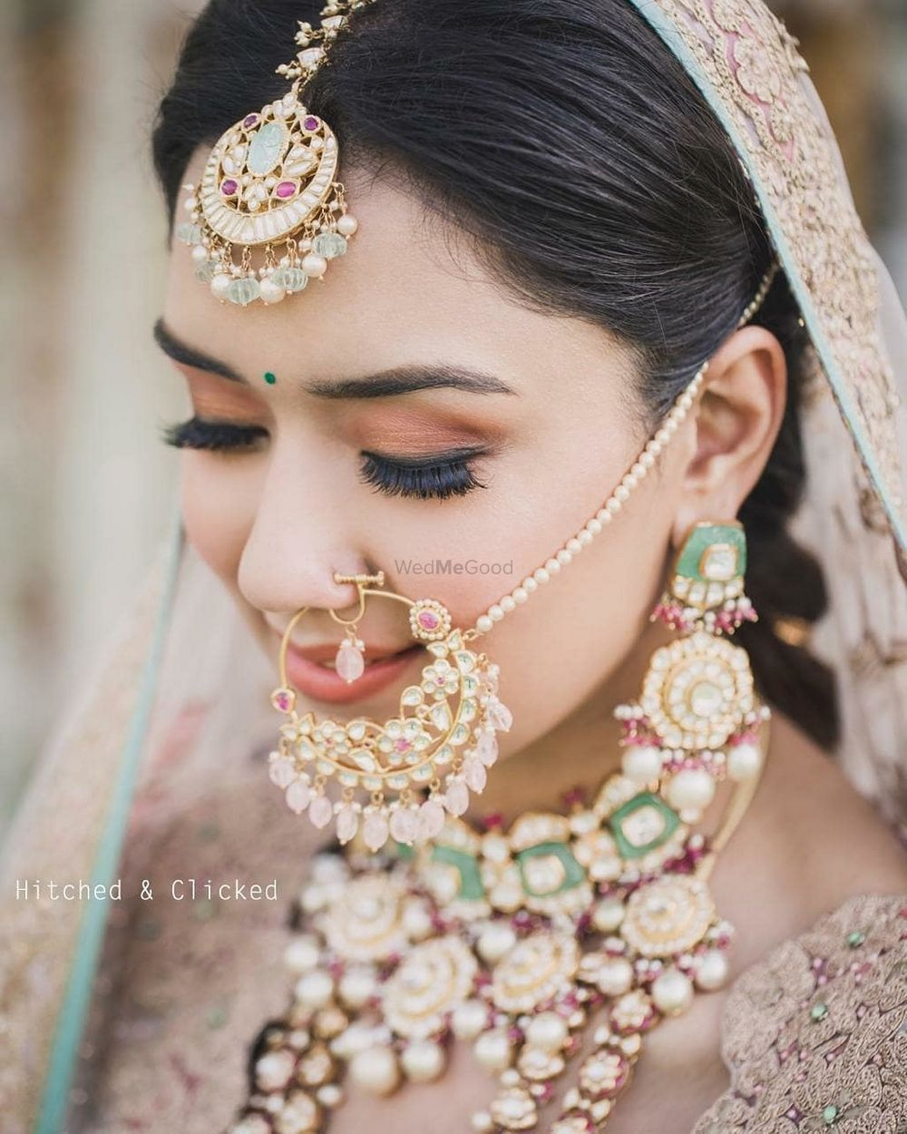 Photo of bridal jewellery with enamel work and unique nath