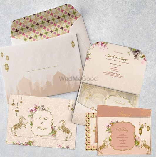Photo of Taj mahal theme wedding invitation card in white and blush pink