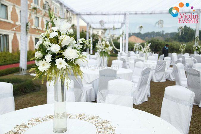 Photo of White theme table setting decor