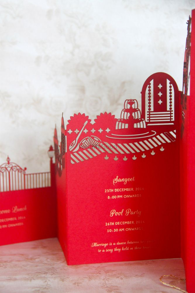 Photo of Red laser cut layered wedding card