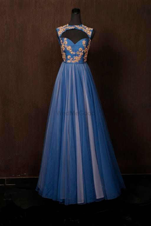 Photo of blue and grey floor length gown with peep hole cutout front