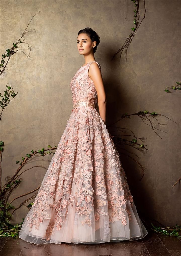 Photo of sleeveless light pink gown with flowers all over
