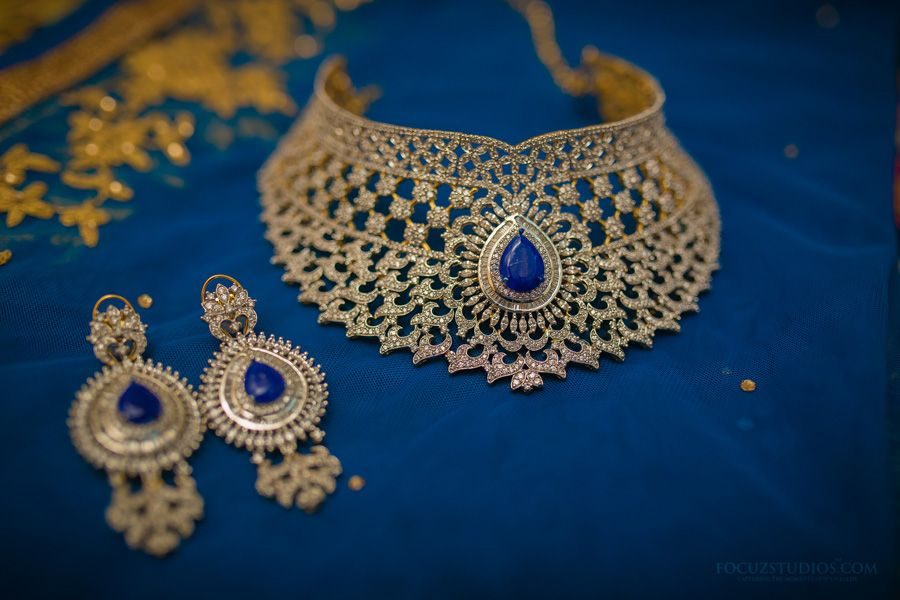 Photo of gold bridal choker necklace and earrings