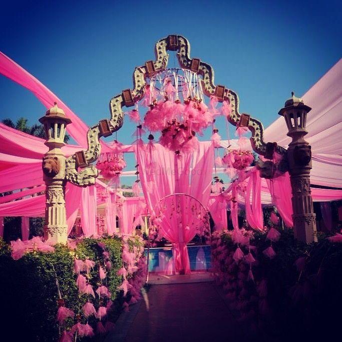 Photo of drape style entrance wedding decor