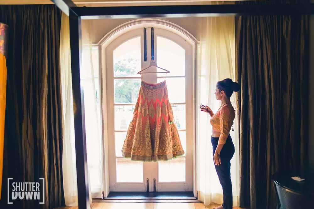 Photo of coral bridal lehenga