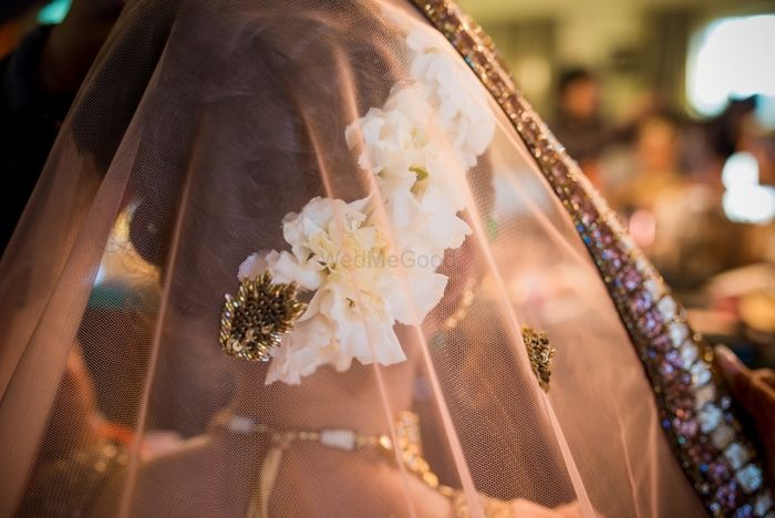 Photo of Bridal bun with white flowers