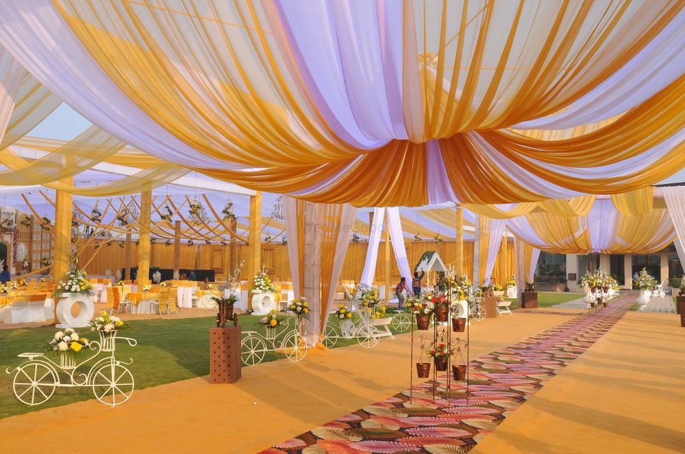Photo of day wedding yellow and white canopy tents decor