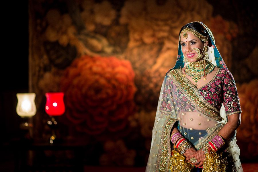 Photo of Offbeat bridal lehenga in blue and pink with floral motifs