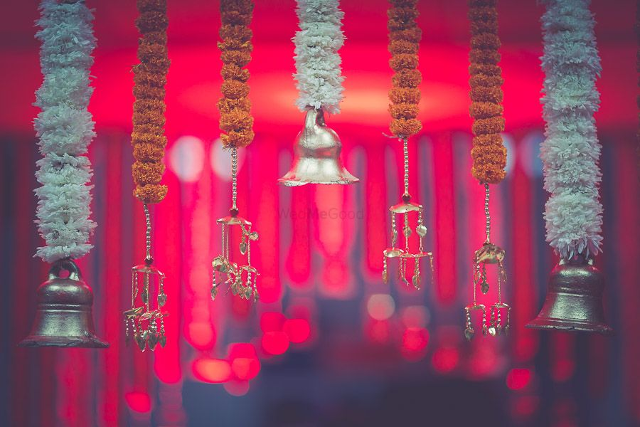 Photo of Hanging floral strings with temple bells and kaleere