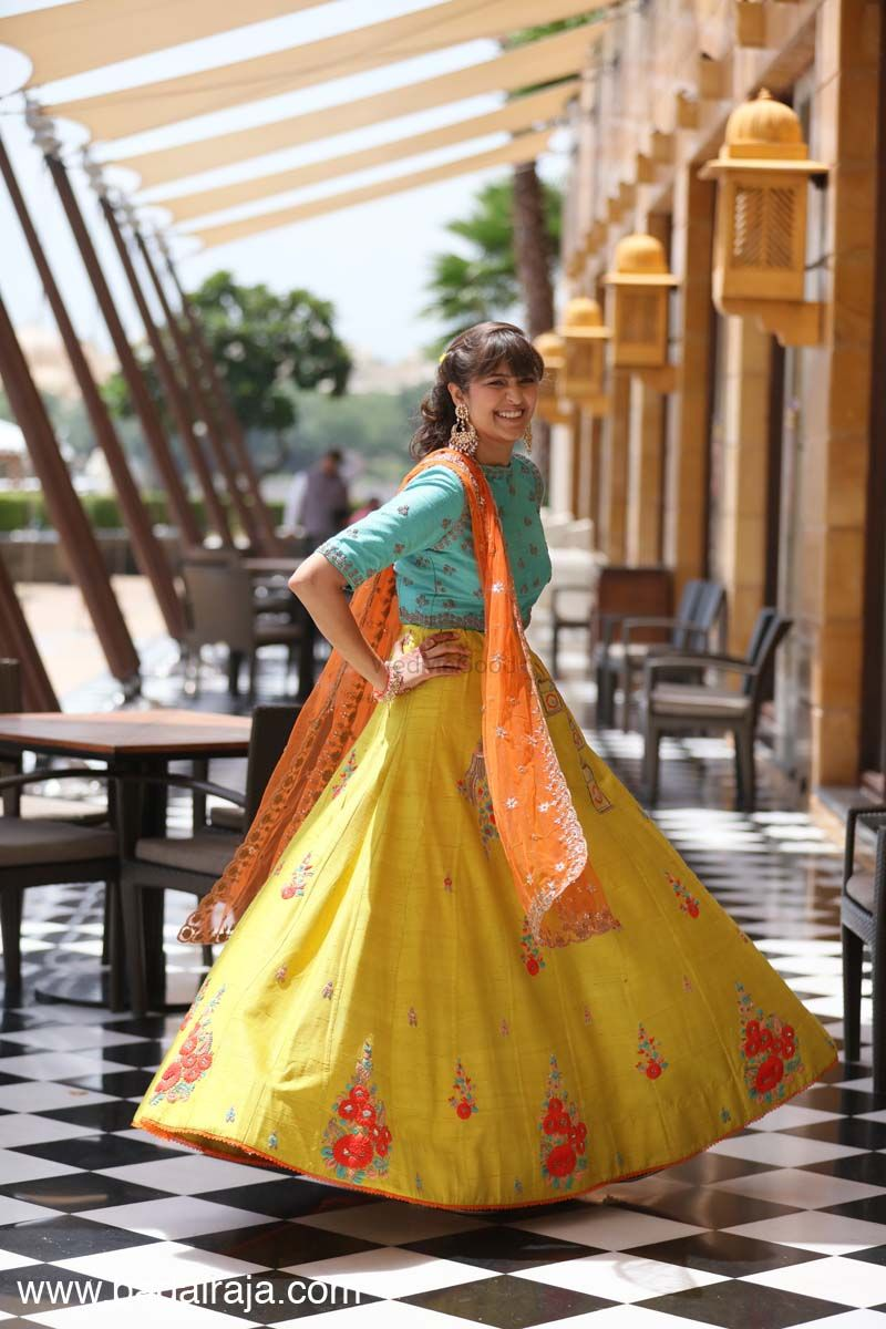 Photo of Turquoise and yellow lehenga for mehendi with high neck blouse