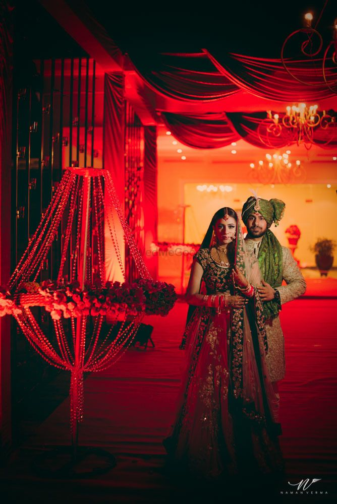 Photo of Glam couple portrait shoot with red decor