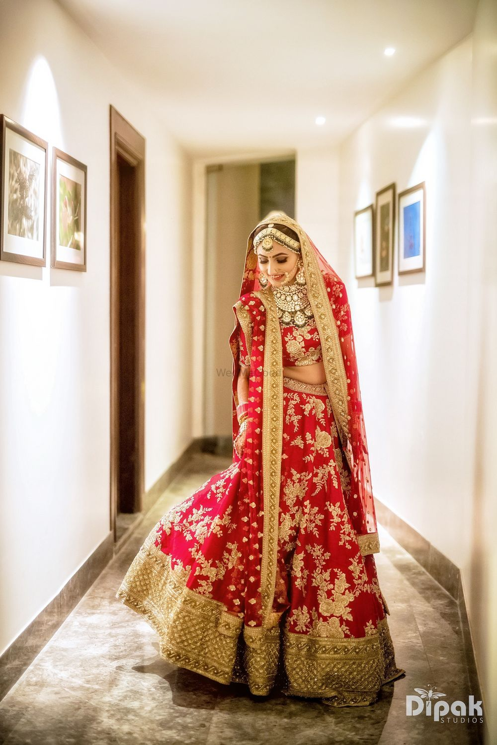 Photo of Red and gold floral embroidery lehenga for bride