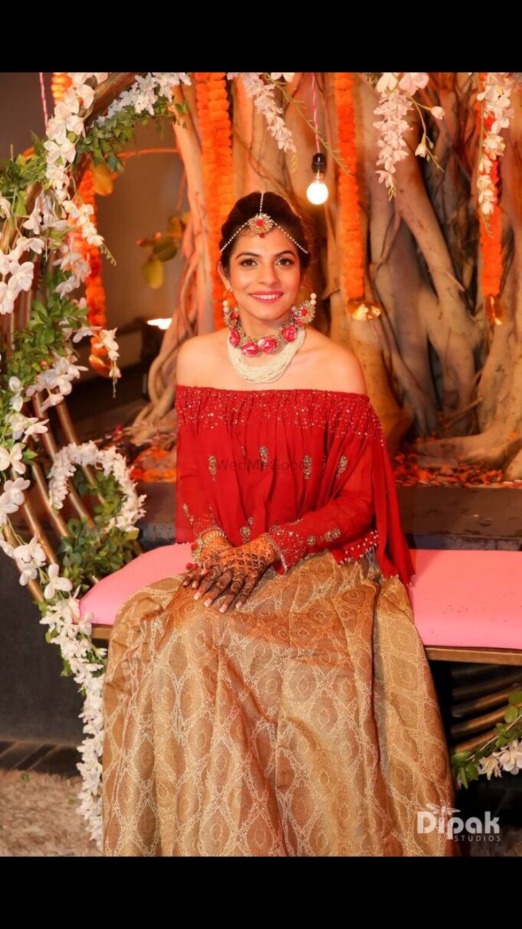 Photo of Off shoulder lehenga for mehendi in red and gold