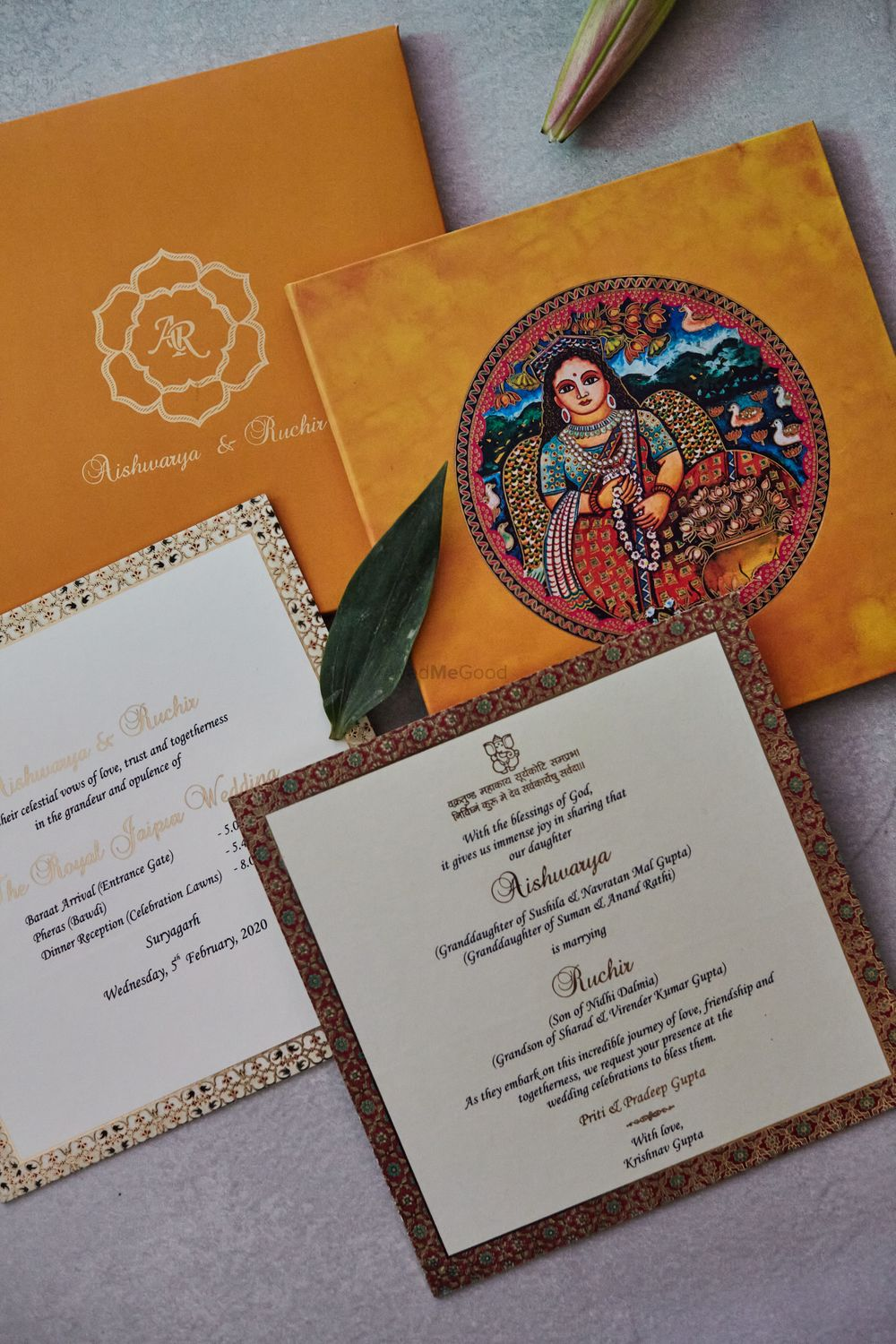 Photo of unique wedding card for palace wedding with design
