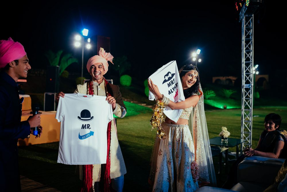 Photo of Couple holding customised tshirts