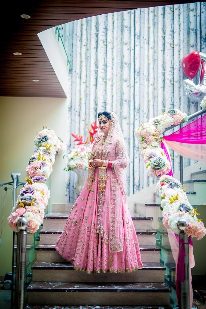 Photo of Morning bride in light pink and gold lehenga