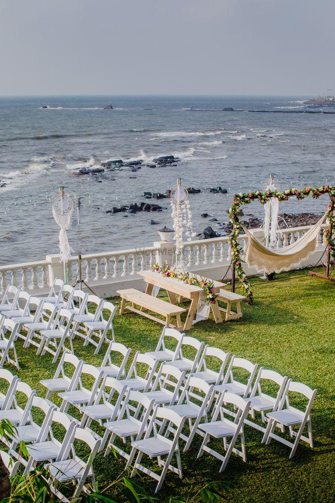 Photo of All white beachside wedding decor seating