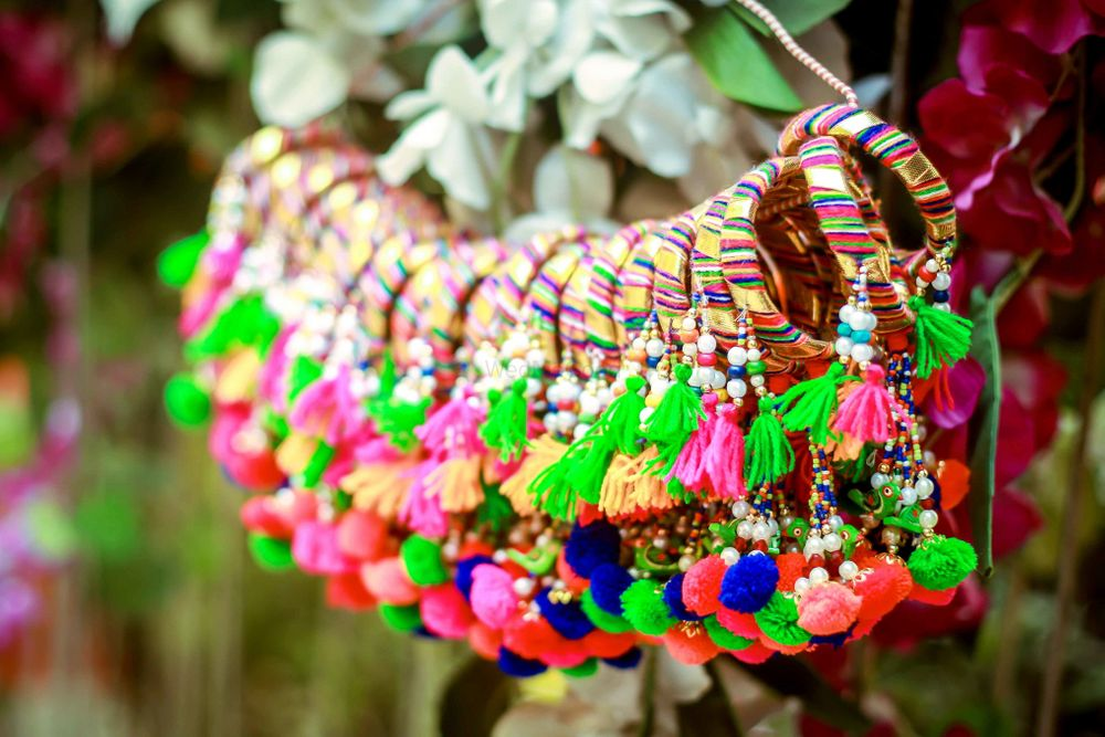 Photo of Hanging gota bangles with tassels and pompoms as mehendi favours