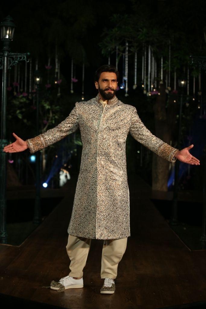 Photo of Embellished gold groom sherwani