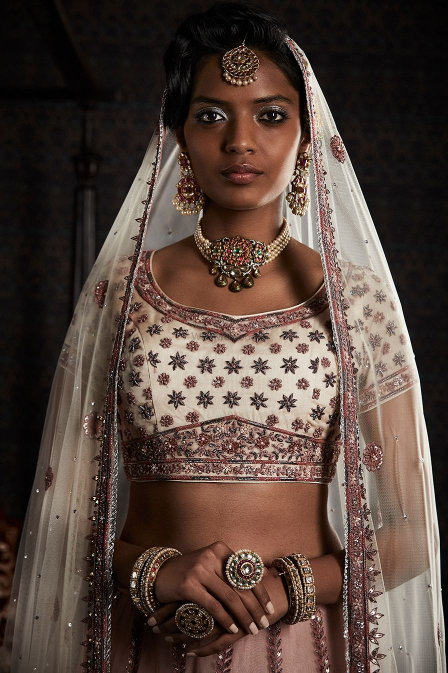 Photo of Dusky bride in white with choker necklace