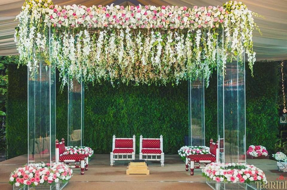 Photo of Hanging floral strings decor for outdoor mandap