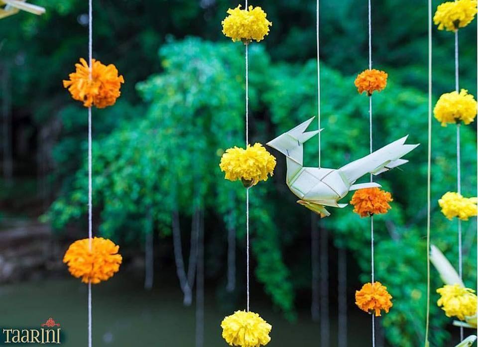 Photo of Paper decor bird with genda flower strings